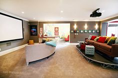looooooove the projector + half moon couch combination. will do in our large basement... one day... *sigh*