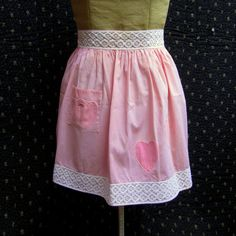Vintage pink and white gingham apron with appliqued pink hearts and vintage white lace trim.