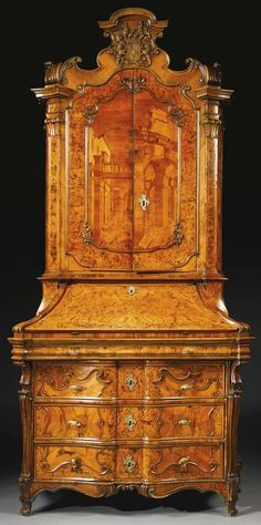 A North Italian rococo walnut, burr walnut and marquetry bureau cabinet Lombardy, circa 1740 the cresting with the coat-of-arms of the Zurlauben family Sotheby's: