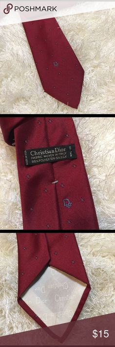 Christian Dior men's tie Beautiful tie in good shape. No rips or stains. Vintage! Deep red with blue detailing. Widest it measures 3 inches. 56 inches long. Bundling is fun; check out my other items! No price talk in comments. No trades or holds. Christian Dior Accessories Ties