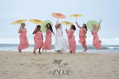Beach bride and her bridesmaids jump in their air with their parasols in Ocean City Maryland after their wedding ceremony with Rox Beach Weddings of OC MD:  https://www.roxbeachweddings.com/
