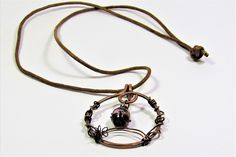 CopperJEWEL oxidized copper wire and bead pendant necklace.