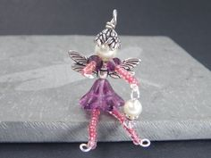 LunamagicK - CEYLAN Flower Fairy Ornament - Beaded Fairy - Fairy Charm - Wine Bottle Decoration - Pink Faery - Purple Faerie - Zipper Pull - Accessory - LunamagicK - Etsy (Sorry, this item is sold).