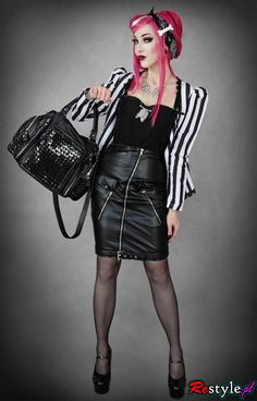 Psychobilly. Not a fan of the jewelry, or the skirt because of the busy zipper/pocket combo, but I dig everything else.