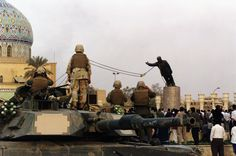 The famous April 2003 toppling of Saddam Hussein's statue in Firdos Square in Baghdad shortly after the Iraq War invasion. Iraqis greeted the Americans in destroying the symbol of an oppressive, greedy regime, noted for its invasion of nearby Kuwait in 1990.