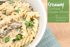 Creamy Crockpot Chicken Alfredo-RECIPE -2 large or 4 medium chicken breasts (can be frozen!) •1 can cream of chicken (or mushroom) soup •½ cup Italian dressing •2 cloves of garlic, minced •1 small can sliced mushrooms, drained •1 8 oz block of cream cheese •½ to 1 bag of frozen peas or broccoli •1 lb spaghetti or other noodles