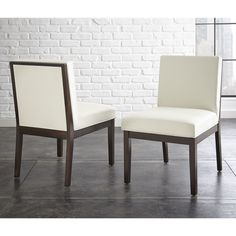 Fall in love with the contemporary style of the Zuri bonded leather chairs. Available in white or black, the chair offers clean lines and a generously cushioned seat and back combine to create this comfortable and very versatile chair.