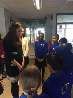 The Duchess of Cambridge opened the Clore Art Room at Barlby Primary School, London, January 15, 2015; the Duchess chats with some of the children.