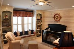 Fascinating Images Of Various Nautical Themed Furniture For Interior Decoration: Epic Picture Of Nautical Baby Nursery Room Decoration Using Oak Wood Boat Steer Bedroom Wall Decor Including Black Wood Curved Baby Cribs And Bay Window Seating In Baby Room ~ groliehome.com Interior Inspiration