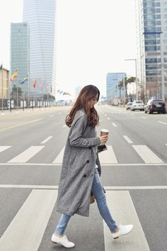 Long grey coat, jeans & oxfords.