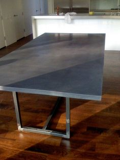 polished concrete dining table with steel base