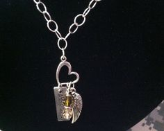 Save extra 15% with coupon at HeavenlyGiggles Bonanza store.  Army Wife Angel Necklace  $24 + 15% off.