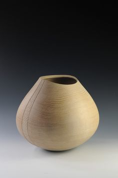Liam Flyyn works primarily in Irish oak turning strong, simple and lyrical vessel forms.