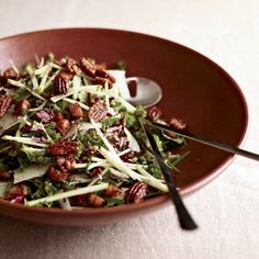 Kale and Apple Salad with Pancetta and Candied Pecans | Kale is a marvelous green for salads because it's hearty enough to handle hefty ingredients like nuts and meat, plus it doesn't wilt as it sits on the table.