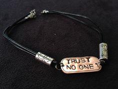 Trust No One, X-files inspired leather bracelet.. $18.00, via Etsy.