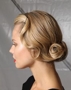 If your hair is longer than shoulder length it can be pinned and manipulated into an elegant 20's inspired style that will look lovely with a birdcage veil.