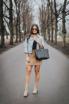 Corduroy Front Zip Skirt | A Southern Drawl. Black top+camel suede skirt+pale brown ankle boots+denim jacket+black handbag+black choker+aviator sunglasses. Winter Casual Outfit 2017