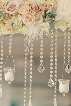 Candle holders hanging from crystal garlands are the perfect backdrop for an outdoor ceremony space. Source: etsy #candles #crystals #ceremonydecor