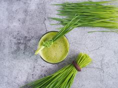 Fresh wheat grass juice and wheatgrass plant for health on top view. Wheat Grass, Celery, Juice, Photo Editing, Nutrition, Stock Photos, Fresh, Top View, Vegetables