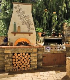 Outdoor kitchen and pizza oven.  Brick and stucco finish combo