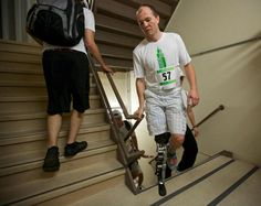 The metal on Zac Vawter bionic leg gleamed as he climbed 103 floors of Chicago's iconic Willis Tower, becoming the first person ever to complete the task wearing a mind-controlled prosthetic limb. The robotic leg is designed to respond to electrical impulses from muscles in his hamstring. When Vawter thought about climbing the stairs, the motors, belts and chains in his leg synchronized the movements of its ankle and knee.