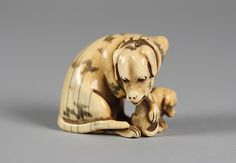 Netsuke of Dog and Puppy Date: 19th century Culture: Japan Medium: Ivory Dimensions: H. 1 3/4 in. (4.4 cm); W. 2 in. (5.1 cm)