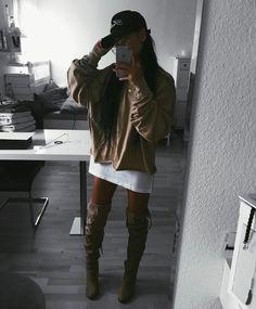 Thigh high boots. Tshirt dress. Tan outfit. Long hair.