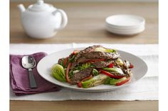 Stir up our Asian Beef with Baby Bok Choy recipe! Made with veggies, steak and sesame dressing, our Asian Beef with Baby Bok Choy recipe is sure to please. Bok Choy Recipes, Pork Recipes, Asian Recipes, Cooking Recipes, Healthy Recipes, What's Cooking, Oriental Recipes, Oriental Food, Healthy Foods