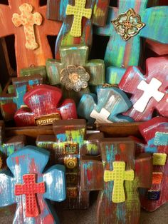 display of wooden cross with attached pottery