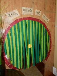 Hobbit door made with oaktag, wood-grained contact paper, and crepe paper all from Dollar Tree