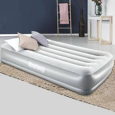 Featuring a comfortable flocked sleeping surface, the Single size air bed provides a smooth and comfy sleep each and every night. Combined with a sturdy coil-beam construction and built-in electric pump, this quality air bed is suitable for both indoor and outdoor use. #airbed #inflatableairbed