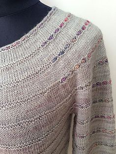 Junimond is a top down sweater with 3/4 sleeves which is shaped by a combination of techniques.