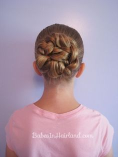 My girls hair for ballet-Double Braided Bun from babes in hairland. (pony tail, divided in half and braided and pined)