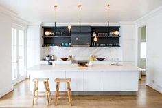 This kitchen is gorgeous, open and makes great use of the white and wood design - however, we also love the black overhead shelves. Scandinavian Kitchen by ATTIK Design Elegant Kitchens, Cool Kitchens, Kitchen Colors, Kitchen Decor, Best Kitchen Designs, Scandinavian Kitchen, Custom Kitchens, Kitchen Trends, Kitchen Ideas