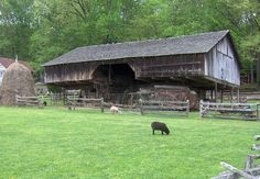 """Cantilever (or """"Overhang"""") barn at the Museum of Appalachia in Norris, Tennessee, USA. This barn was originally located near Seymour, Tennessee. The Appalachian cantilever barn, derived from similar European barn designs, is rarely found in the United States outside the mountains of East Tennessee."""""""