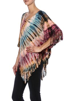 Casual and fun, this multicolored tie-dye hi-low poncho has fringe detail and sewn sleeve holes.   Tie-Dye Fringe Poncho by Talk of the Walk. Clothing - Tops - Casual Clothing - Tops - Short Sleeve New Jersey Atlantic City, New Jersey