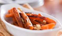 Maple Glazed Carrots.   Cooking carrots in a maple glaze with a hint of butter brings out the best flavour from your carrots.