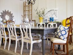 Grey Farmhouse Table and White Chairs Set sold by noteworthyhome, $999.00 French chairs, farm house table, turned legs, greige dining room, white chairs, grey table, painted dining, painted chairs, vintage furniture, horse sketch, sunburst mirror