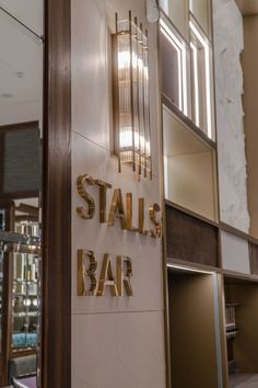 Fabulously stylish brass and glass wall lights have been used to compliment the brass accents of the Stalls bar at the Grand Opera House. Glass Wall Lights, Light Fittings, Belfast, French Door Refrigerator, Opera House, Stalls, Contemporary, Lighting, Brass