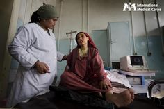October 28: A woman speaks with a concerned doctor at Rabia Balkhi Hospital for Women in Afghanistan. Photo: Kate Holt, International Medical Corps, Afghanistan 2010