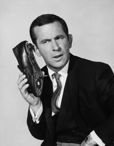 """Maxwell Smart from """"Get Smart"""" listening to his """"shoe phone""""!  Weren't times different then?!?!  ;)"""