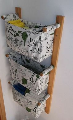 Handy fabric baskets on a wall bracket- would be great for a baby's room!