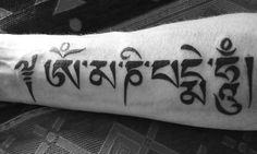 My first one last year :-)  om mani padme hum mantra in Tibetan script