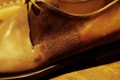 Compass tattoo on leather shoes
