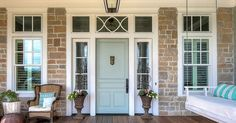 White trim and a pop of color on a front door can beautify a stone home!