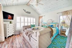 This Rehoboth Beach house by Echelon Custom Homes boasts turquoise, coral, yellow and other bold and bright colors. Turquoise Bedroom Decor, Turquoise Bedding, Blue Bedding, Turquoise Rug, Turquoise Kitchen, Bedroom Colors, House Of Turquoise, Vaulted Ceiling Bedroom, Plank Ceiling