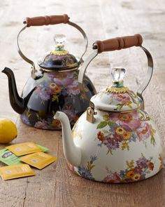 Handcrafted tea kettle. Enameled heavy-gauge steel; lid topped with acrylic, brass and glass accents. Glazed and decorated with hand-applied botanical transfers. Pieces will vary due to the handmade n