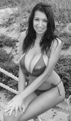 Jana Defi - metallic bikini - seated pose
