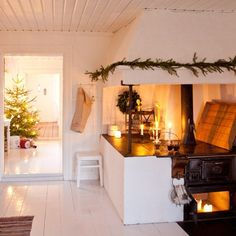 Old cast iron cocking stove in Scandinavian house decorated for Christmas