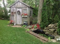 decorated Sheds with Porch | decorated old shed surrounded by flowers.